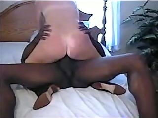 Horny wife riding black bull